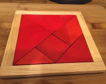 Second-hand Wooden Tangram Puzzle with instruction booklet by an educator