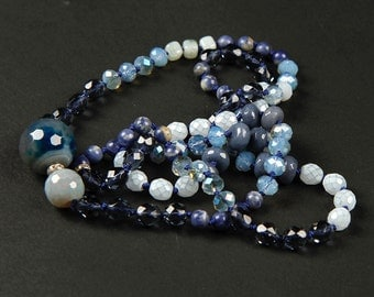 Hand knotted necklace with blue gemstones