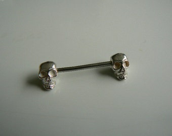 Silver skulls screw on (1 complete barbell 14ga)