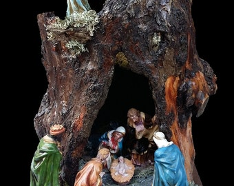 Nativity in tree trunk