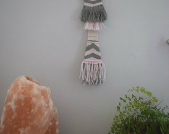 Grey and pink skinny woven wall hanging