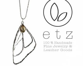 Butterfly pendant with a teardrop smokey quartz