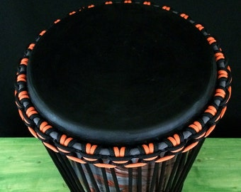 Ashiko drum with dyed goat skin.  Amazingly swirl painted orange, gray, and black to match rope work.