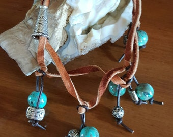 Earthly turquoise ceramics beads accenting leather bracelet