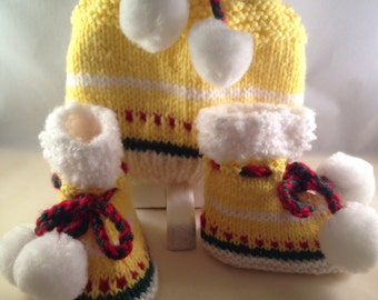 Yellow knitted hat and booties