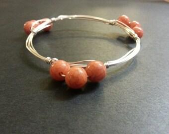 Stackable wire bangle bracelet orange
