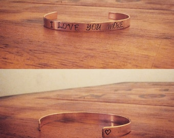 "Handmade metal stamped ""I love you more"" cuff bracelet"