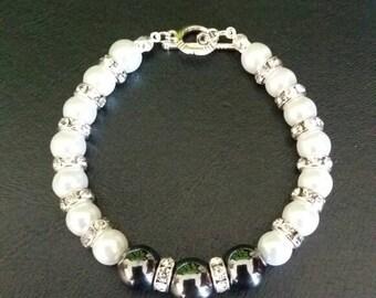 Hermatite and glass pearl bracelet