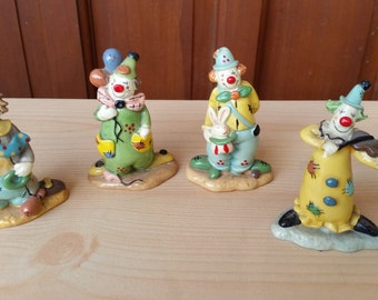 Set of 4 Porcelain Clowns