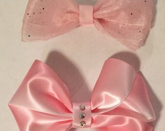 2 pink bows with alligator clips