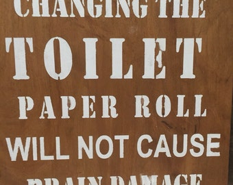 Wood sign - Hand  painted- changing the toilet paper roll will not cause brain damage.