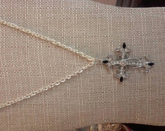 Silver cross necklace.