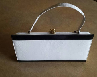 Black and White: Hill and Dale handbag. Black section is  patent leather. White part is leather ( Ostrich skin?)