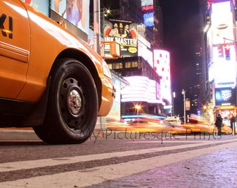 Taxi standing @ night on Times Square in New York. NYC