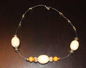 "Wooden cream and peach beads necklace, 18"", metal string and golden color beads"