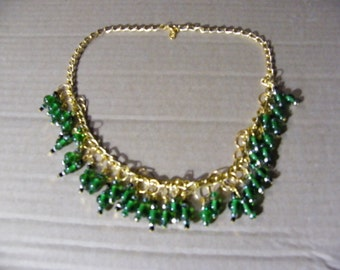 Gold plated chain with Green and Black beads