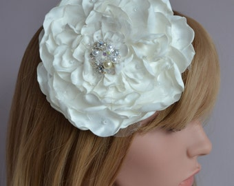 Large flower bridal fascinator.