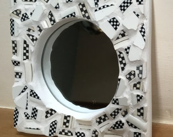 Broken china mirror, black and white checks