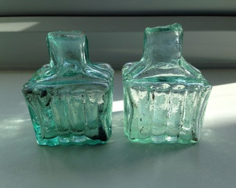 2 antique glass inkbottles with shear tops