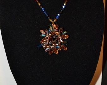 Vintage dark amber & blue rhinestone  (#26)