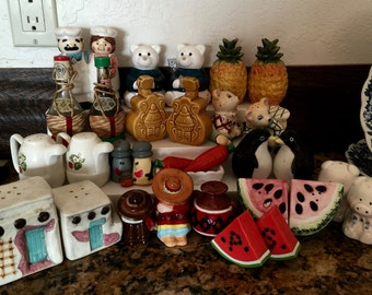 Vintage Salt & Pepper Shakers. 14 in all with one plastic toy, 4 tier plastic stand.