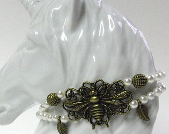 Wonderful Demeter bracelet with bees ornament