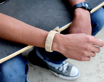 """The """"Circle"""" Leather charging band."""