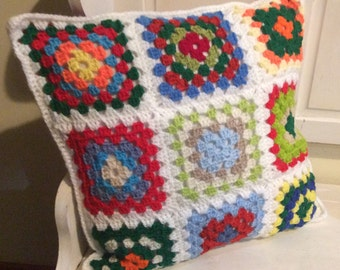 Lovely granny square crocheted cushion