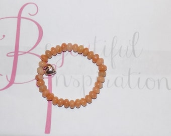 Lovely Beaded Bracelet With Silver Tone Heart