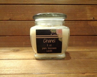 100% beeswax 8 oz scented candle in square glass jar .