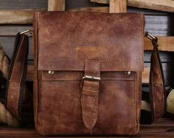 Shoulder cowhide leather bag. Brown color messenger bag, leather strap.