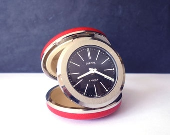 mechanical alarm clock, red folding clock, travel clock, timepiece, Europa 2Jewels chronograph from the 70s, made in Germany