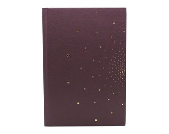 Guestbook in plum leather Golden hand