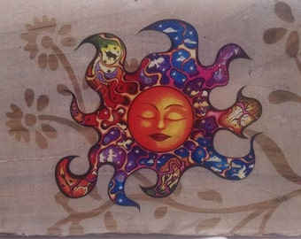 Striking sun with lace mounted on wood