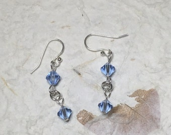 light blue, dark blue, or red earrings. Made with Swarovski crystals