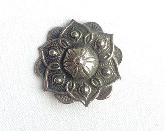 Flower motif pewter brooch