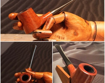 Freehand tobacco pipe.