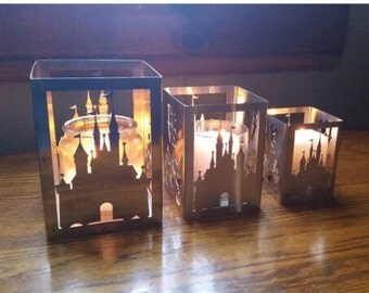 A set of 3 candleholders. 1 large 1 medium and 1 small. You choose your design or mix and match from the different designs we have
