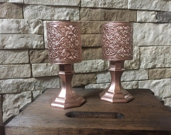 Rose gold candle holders.