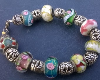 Jewelry Designs by Joy, multicolored glass and metal bead bracelet