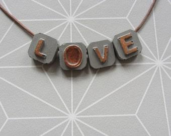 Concrete necklace LOVE leather