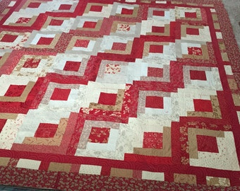 Custom Log Cabin quilt made from Moda Crazy for Red and another Red The General, I think. Could be made in any size.
