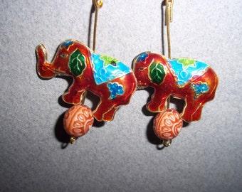 handmade earrings elephant earrings in reddish brown color on gold-tone hooks