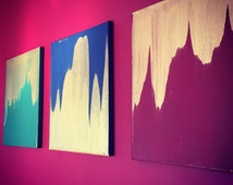 Blue green red and gold streaked acrylic painted canvases