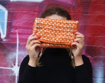 Orange and white seed clutch knitting pattern