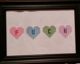 Finished cross stitch. Heart f***