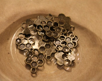 13 honeycomb bronze beads or charms