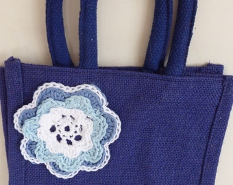 16.  Dark Blue Hessian Lunch Bag with   Hand Crocheted Flowers.