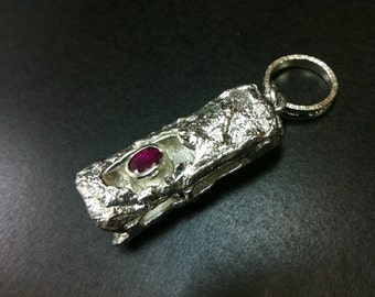 A handmade silver reversible pendant top