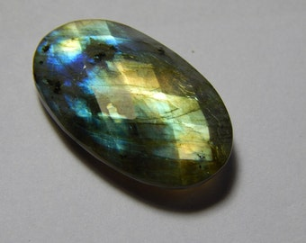 Natural Labradorite Gemstone Faceted Loose Cabochon Oval Shape Multy Power Flash  Size : 15X25 MM Approx Best Quality On Wholesale Price.
